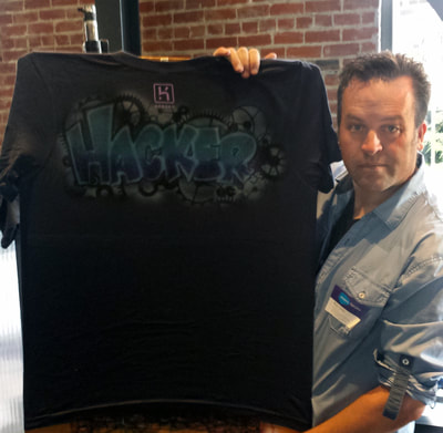 Airbrush tee shirt at corporate event
